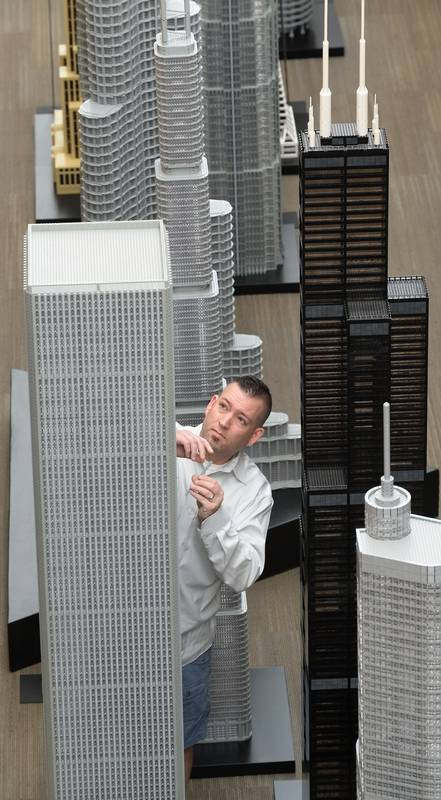 Adam Reed Tucker tending to his One World Trade Centre replica