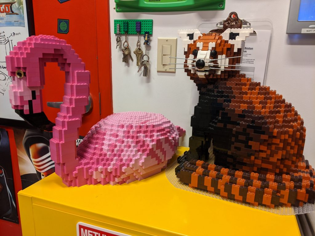 Megan Amaral's LEGO sculptures of a Flamingo and Red Panda for the Franklin Park Zoo. Image by Lauren Josey for Boston.com